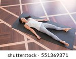 top view young woman meditating ... | Shutterstock . vector #551369371