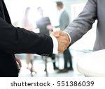 business people shaking hands... | Shutterstock . vector #551386039