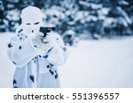 portrait of soldier in camouflage and white mask balaclava with an automatic weapon on the background of a winter forest. Concept photo military, war, hostilities - stock photo