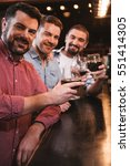 cheerful delighted men raising... | Shutterstock . vector #551414305