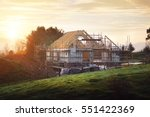 home under construction on a... | Shutterstock . vector #551422369