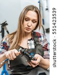 tired craftswoman fixing the... | Shutterstock . vector #551423539