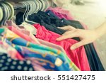 clothes hanging on the rack in... | Shutterstock . vector #551427475