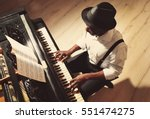 afro american man playing piano | Shutterstock . vector #551474275