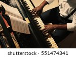 afro american man playing piano | Shutterstock . vector #551474341