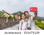 happy couple tourists taking... | Shutterstock . vector #551475139