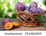 Plum In A Wicker Basket On The...