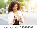 woman walking in a business... | Shutterstock . vector #551498569