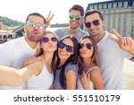 young happy friends pouting and ... | Shutterstock . vector #551510179
