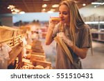 young woman chooses bread in... | Shutterstock . vector #551510431