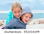 boy and girl playing on the... | Shutterstock . vector #551514199