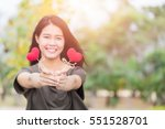 Small photo of Giving love , Asian woman hand hold give beautiful red heart sweet loving symbol of take care or charity help to you.