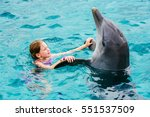young girl swimming with... | Shutterstock . vector #551537509