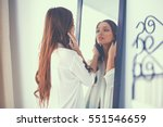 young woman looking herself... | Shutterstock . vector #551546659