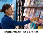 businesswoman reading magazines ... | Shutterstock . vector #551576725