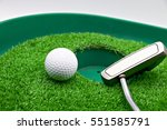 golf ball and putter at the... | Shutterstock . vector #551585791
