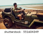 man on jeep on the of road | Shutterstock . vector #551604349