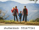 family with two kids hiking in... | Shutterstock . vector #551677261