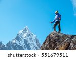 hiker with backpacks reaches... | Shutterstock . vector #551679511