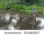fisherman catches tenkara on a... | Shutterstock . vector #551682037