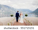wedding couple at destination... | Shutterstock . vector #551715151