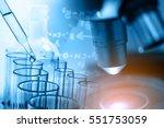 microscope with lab glassware ... | Shutterstock . vector #551753059