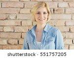 portrait of happy young blonde... | Shutterstock . vector #551757205