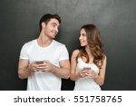 happy couple using phones in... | Shutterstock . vector #551758765