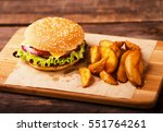 big burger with beef  tomato ... | Shutterstock . vector #551764261