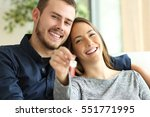 happy couple of owners showing... | Shutterstock . vector #551771995