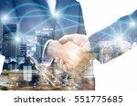 double exposure of handshake... | Shutterstock . vector #551775685