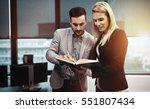 blond secretary helping boss in ... | Shutterstock . vector #551807434
