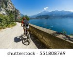 mountain biking at sunrise... | Shutterstock . vector #551808769