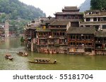 Boats And Wooden Houses At...