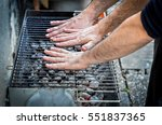 Hands Are Testing The Barbecue...