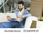 businessman with tablet sitting ... | Shutterstock . vector #551844919