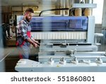 carpenter doing his job in... | Shutterstock . vector #551860801