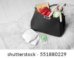 mothers bag with accessories on ... | Shutterstock . vector #551880229