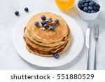 pancakes with fresh blueberries ... | Shutterstock . vector #551880529