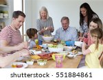 large family are sat round a... | Shutterstock . vector #551884861