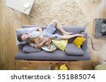 man is lying on the sofa in the ... | Shutterstock . vector #551885074