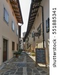 Small photo of SMARTNO, SLOVENIA - SEPTEMBER 27, 2016: Narrow medieval street with cafe and small hotel Marica. Smartno is a village in Brda region. The entire village has been declared a cultural heritage site.
