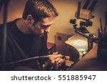 jeweler at work in jewelery... | Shutterstock . vector #551885947