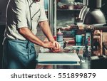 young white chef in kitchen... | Shutterstock . vector #551899879