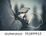 man operating a drone using a... | Shutterstock . vector #551899915