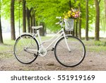 white vintage bicycle with... | Shutterstock . vector #551919169