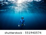woman free diver ascending from ... | Shutterstock . vector #551940574