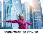 Small photo of Sporty healthy model wearing pink hoody, feeling alive with arms outstretched to sky, closed eyes, enjoying bliss, fresh air, thanking for good weather, doing yoga, fitness outdoor, urban background