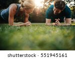 healthy young couple exercising ... | Shutterstock . vector #551945161