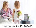 little girl hiding bouquet of...   Shutterstock . vector #551946409